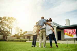 Shot of a family of four viewing their new home together